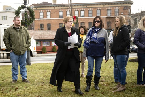 (AP Photo/Matt Rourke). Shira Goodman, center, executive director of CeaseFire PA, accompanied by plaintiff Holly Koscak, center right, walks to the podium during news conference in Tamaqua, Pa., Friday, Jan. 4, 2019, about a new lawsuit to block the T...