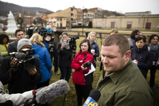(AP Photo/Matt Rourke). Tamaqua Area School Board member Nicholas Boyle speaks in support of arming teachers and other school employees, to members of the media after a news conference in Tamaqua, Pa., Friday, Jan. 4, 2019. Parents are going to court t...