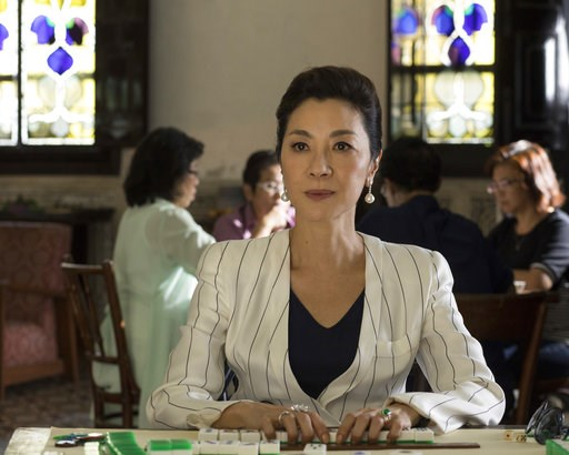 """(Sanja Bucko/Warner Bros. Entertainment via AP). This image released by Warner Bros. Entertainment shows Michelle Yeoh in a scene from the film """"Crazy Rich Asians.""""  The movie is up for two Golden Globe nominations, including best comedy or musical. Th..."""