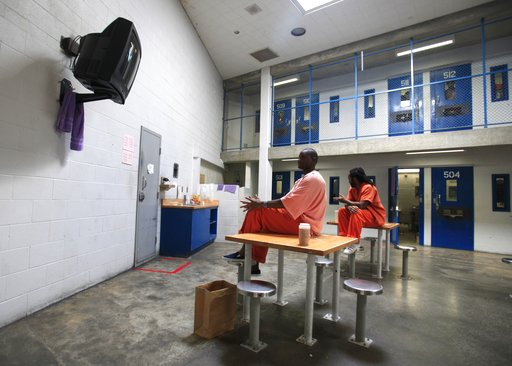 (AP Photo/Rich Pedroncelli, File). FILE - In this Sept. 27, 2011 file photo, Sacramento County inmates watch television at the Rio Cosumnes Correctional Center, in Elk Grove, Calif. Gov. Jerry Brown has spent much of his second two terms reducing crimi...