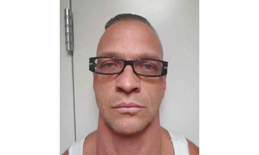 (Nevada Department of Corrections via AP, File). FILE - This undated file photo provided by Nevada Department of Corrections photo shows death row inmate Scott Raymond Dozier, who was convicted in 2007 of robbing, killing and dismembering a 22-year-old...