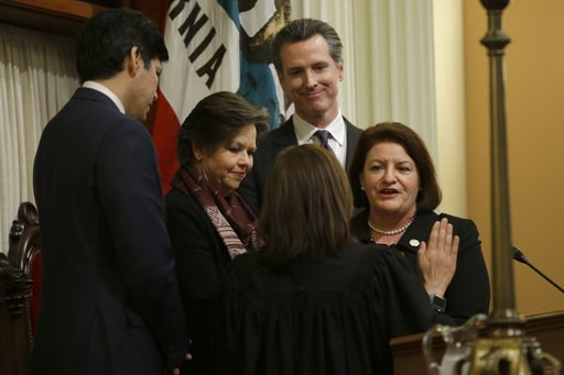 (AP Photo/Rich Pedroncelli, File). FILE- In this March 21, 2018 file photo, Lt. Gov. Gavin Newsom, second from right, watches as State Sen. Toni Atkins, D-San Diego, right, is sworn in as the new President Pro Tempore of the Senate by California Suprem...