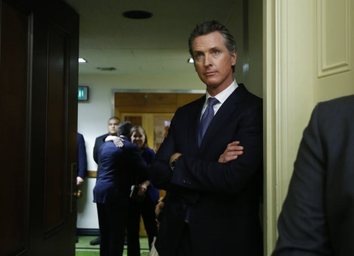 (AP Photo/Rich Pedroncelli, File). FILE - In this Dec. 3, 2018 file photo Governor-elect, Lt. Gov. Gavin Newsom, watches the Assembly session at the Capitol, Monday, Dec. 3, 2018, in Sacramento, Calif. Newsom, will be sworn-in to office Jan. 7, 2019, a...
