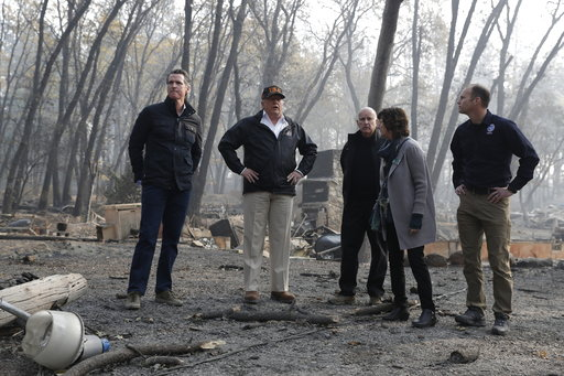 (AP Photo/Evan Vucci, File). FILE - In this Nov. 17, 2018 file photo, President Donald Trump talks with from left, Gov.-elect Gavin Newsom, FEMA Administrator Brock Long, right, Jody Jones, Mayor of Paradise, and California Gov. Jerry Brown during a vi...