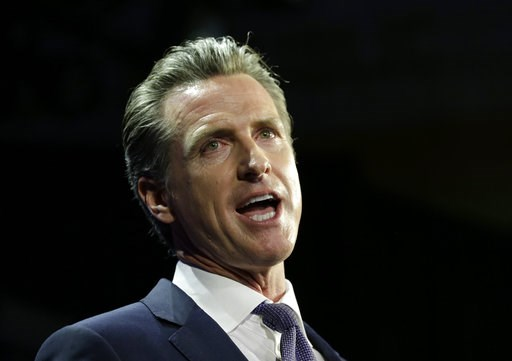 (AP Photo/Rich Pedroncelli, File). FILE - In this Nov. 6, 2018 file photo, Lt. Gov Gavin Newsom, a Democrat, addresses an election night crowd, in Los Angeles, after he defeated Republican John Cox to become the 40th governor of California. Newsom, wil...