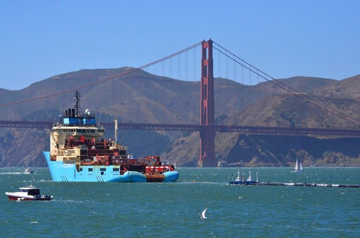 (AP Photo/Lorin Eleni Gill, File). FILE- In this Sept. 8, 2018 file photo, a ship tows The Ocean Cleanup's first buoyant trash-collecting device toward the Golden Gate Bridge in San Francisco en route to the Pacific Ocean. A trash collection device dep...