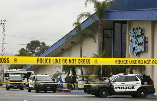 (AP Photo/Damian Dovarganes). Police officers investigate a shooting incident with multiple fatalities at the Gable House Bowl in Torrance, Calif., Saturday, Jan. 5, 2019. A brawl between two large groups at the popular Los Angeles-area bowling alley a...