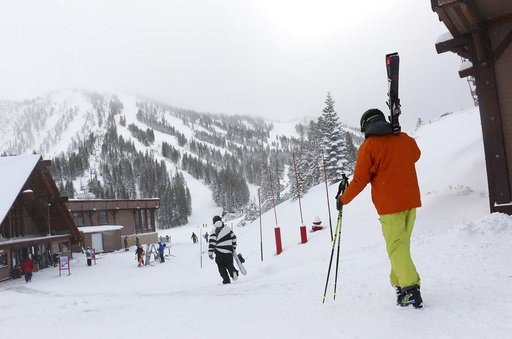 (Jason Bean/The Reno Gazette-Journal via AP, File). FILE - In this Nov. 29, 2018, file photo, skiers and snowboarders walk to the lifts at Mt. Rose Ski Tahoe near Reno, Nev. Avalanche warnings have been posted in parts of California, Nevada and Utah af...