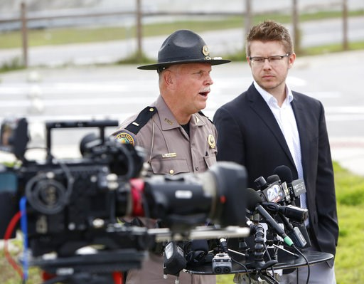 (Brad McClenny/The Gainesville Sun via AP). Florida Highway Patrol Lt. Pat Riordan, left, along with Troy Roberts, the spokesperson for the Florida Department of Transportation,  updates members the media during a press conference, Friday, Jan. 4, 2019...