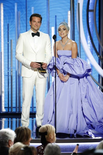 (Paul Drinkwater/NBC via AP). This image released by NBC shows Bradley Cooper, left, and Lady Gaga presenting the award for best actor in a TV comedy series at the 76th Annual Golden Globe Awards at the Beverly Hilton Hotel on Sunday, Jan. 6, 2019, in ...