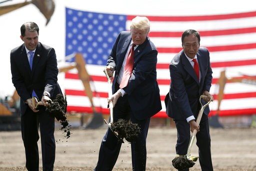 (AP Photo/Evan Vucci, File). FILE - In this June 28, 2018, file photo, President Donald Trump, center, Wisconsin Gov. Scott Walker, left, and Foxconn Chairman Terry Gou, right, participate in a groundbreaking event for the new Foxconn facility in Mt. P...