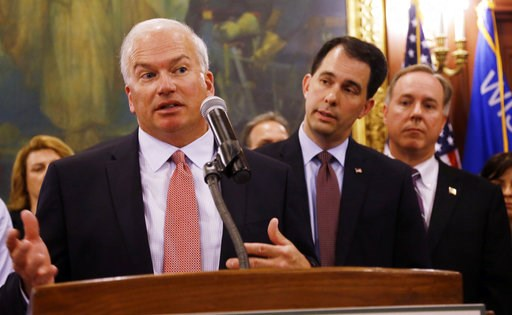 (AP Photo/Morry Gash, File). FILE - In this June 4, 2015 file photo, Republican Senate Majority Leader Scott L. Fitzgerald, left, speaks accompanied by Gov. Scott Walker, center, and Assembly Speaker Robin Vos, right, in Madison, Wis. Walker is leaving...