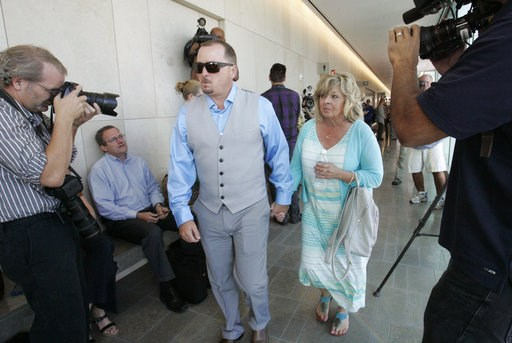 (John Gibbins/The San Diego Union-Tribune via AP, Pool). FILE - In this June, 15, 2015, file photo, Michael McStay, brother of the victims, and Susan Blake, their mother, arrive at court for the preliminary hearing for accused killer Chase Merritt in S...