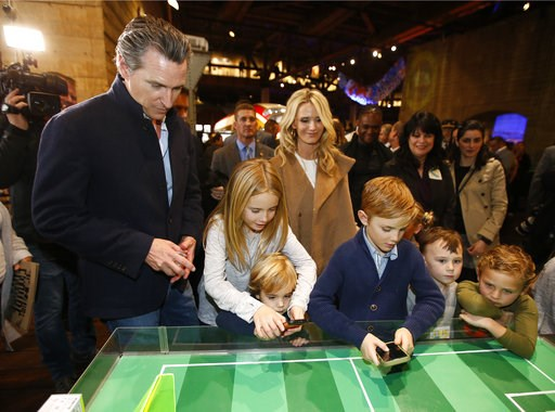 (AP Photo/Rich Pedroncelli). Governor-elect, Lt. Gov. Gavin Newsom, left, and his wife, Jennifer Siebel Newsom, center, watch last their children, daughter Montana, second from left, and sons, Dutch, foreground and Hunter, foreground fourth from left, ...