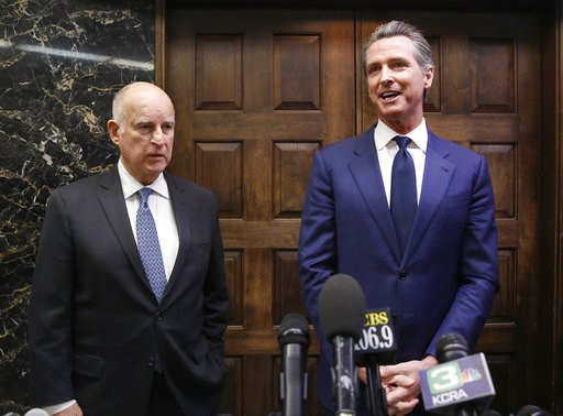 (AP Photo/Rich Pedroncelli, File). FILE- In this Nov. 13, 2018 file photo California Gov.-elect Gavin Newsom, right, and Gov. Jerry Brown talk with reporters after their meeting at the Capitol, Tuesday, Nov. 13, 2018, in Sacramento, Calif. Newsom will ...