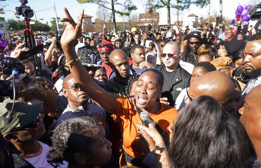 (Melissa Phillip/Houston Chronicle via AP). LaPorsha Washington, center, the mother of seven-year-old daughter Jazmine Barnes, who was killed on Sunday, speaks to the crowd during a community rally outside Walmart, Saturday, Jan. 5, 2019, in Houston. J...