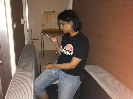 (Rahaf Mohammed Alqunun/Human Rights Watch via AP). In this Monday, Jan. 7, 2019, photo released by Rahaf Mohammed Alqunun/Human Rights Watch, Rahaf Mohammed Alqunun views her mobile phone as she sits barricaded in a hotel room at an international airp...