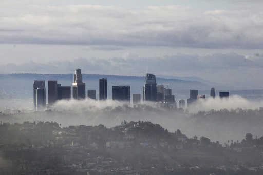 (AP Photo/John Antczak). High-rises of downtown Los Angeles rise above clouds and mist on Sunday, Jan. 6, 2019, after an overnight storm that brought rain and mountain snow to Southern California. Rains unleashed debris flows from wildfire-scarred area...