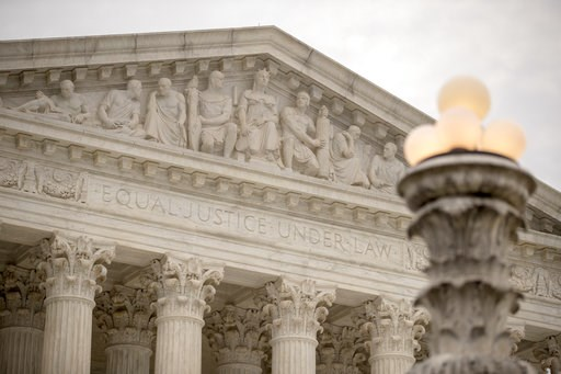 (AP Photo/Andrew Harnik). The Supreme Court in Washington, Monday, Jan. 7, 2019, as the court hears arguments in a case against drugmaker Merck over the warning label on its bone strengthening drug Fosamax.