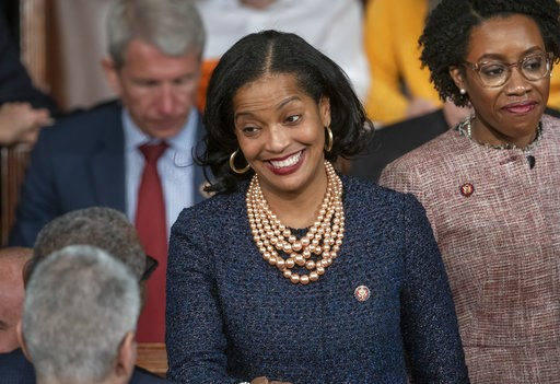 (AP Photo/J. Scott Applewhite, File). File - In this Thursday, Jan. 3, 2019, file photo, Rep. Jahana Hayes, D-Conn., center, talk on the first day of the 116th Congress with Democrats holding the majority under the leadership of Rep. Nancy Pelosi of Ca...