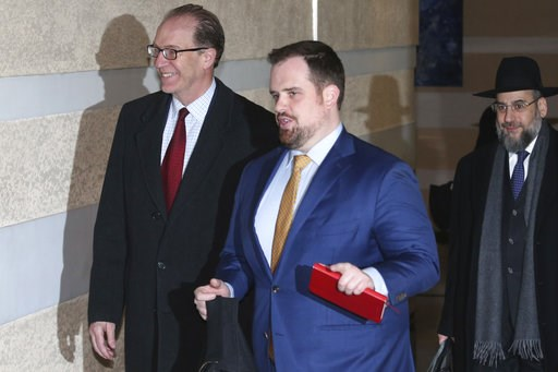 (AP Photo/Ng Han Guan). U.S. Undersecretary for International Affairs David Malpass, left, who is part of U.S. trade delegation leaves from a hotel for a second day of meetings with Chinese officials in Beijing, China, Tuesday, Jan. 8, 2019. Facing a M...