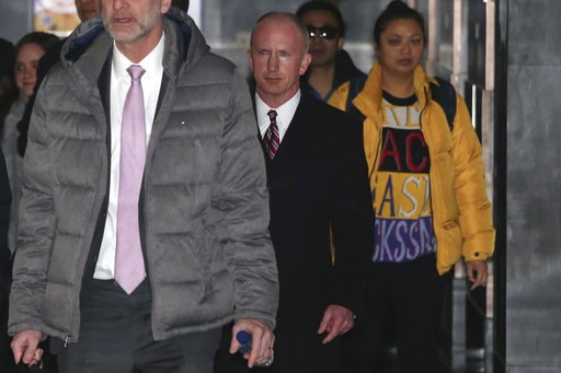 (AP Photo/Ng Han Guan). Deputy U.S. trade representative, Jeffrey D. Gerrish, center, who is leading a U.S. trade delegation leaves from a hotel for a second day of meetings with Chinese officials in Beijing, China, Tuesday, Jan. 8, 2019. Facing a Marc...