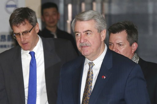(AP Photo/Ng Han Guan). U.S. Undersecretary for Trade and Foreign Agricultural Affairs Ted McKinney, center, who is part of U.S. trade delegation leaves from a hotel for a second day of meetings with Chinese officials in Beijing, China, Tuesday, Jan. 8...