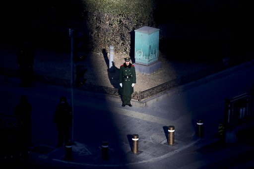 (AP Photo/Andy Wong). A beam of sunlight is cast on a Chinese paramilitary policeman stand guard on a roadside to maintain safety arrival for visiting North Korean leader Kim Jong Un, in Beijing, Tuesday, Jan. 8, 2019. Kim is making a four-day trip to ...