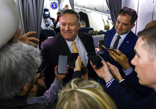 (Andrew Caballero-Reynolds/Pool via AP). U.S. Secretary of State Mike Pompeo talks to reporters on his plane on his way to the Middle East, Monday, Jan. 7, 2019.