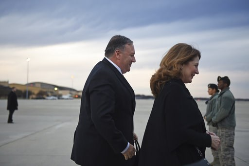(Andrew Caballero-Reynolds/Pool Photo via AP). U.S. Secretary of State Mike Pompeo and his wife Susan Pompeo walk to the plane prior to departing from Joint Base Andrews on Monday, Jan. 7, 2019. Pompeo is traveling to the Middle East.