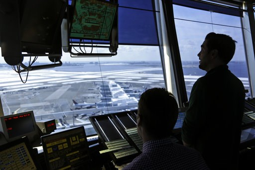 (AP Photo/Seth Wenig, File). FILE - In this March 16, 2017, file photo, air traffic controllers work in the tower at John F. Kennedy International Airport in New York. The partial government shutdown is starting to effect air travelers. Over the weeken...