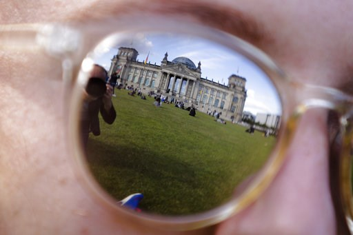 (AP Photo/Markus Schreiber, file). FILE - The Sept. 22, 2017 file photo shows the Reichstag building, which host the German parliament Bundestag as it is reflected in the sunglasses of a woman in Berlin. German Interior Minister Horst Seehofer will inf...