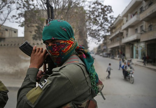 (AP Photo/Hussein Malla, File). FILE -- In this file photo taken on Wednesday, March 28, 2018, a member of the Kurdish internal security forces holds his weapon during a patrol in Manbij, north Syria. The planned U.S. troop withdrawal opens a void in t...