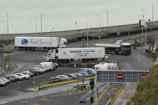 (AP Photo/Matt Dunham). Trucks take part in a no-deal Brexit test, by driving through Dover near the ferry port whilst testing a route from Manston Airfield where 6,000 trucks could be parked as an overspill customs option in south east England, Monday...