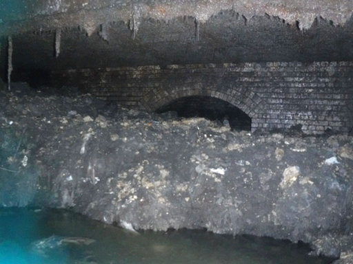 "(South West Water via AP). In this photo released Tuesday Jan. 8, 2019, by Britain's South West Water company, showing part of a ""fatberg"", a mass of hardened fat, oil and baby wipes, measuring some 64 meters (210 feet) long, in the town of Sidmouth, E..."