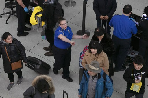 (AP Photo/Mark Lennihan). A TSA agent, center, directs passengers through a security checkpoint, Monday, Jan. 7, 2019, at New York's John F. Kennedy International Airport. Senate Minority Leader Chuck Schumer, D-N.Y., suggested Sunday that the partial ...