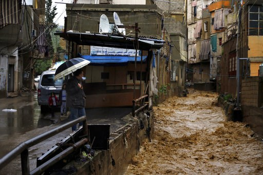 (AP Photo/Bilal Hussein). Rushing rainwater fills a canal in Beirut, Lebanon, Tuesday, Jan. 8, 2019. A strong storm and heavy rainfall turned streets in Lebanon into rivers of water and mud and paralyzed parts of the country. The government ordered sch...