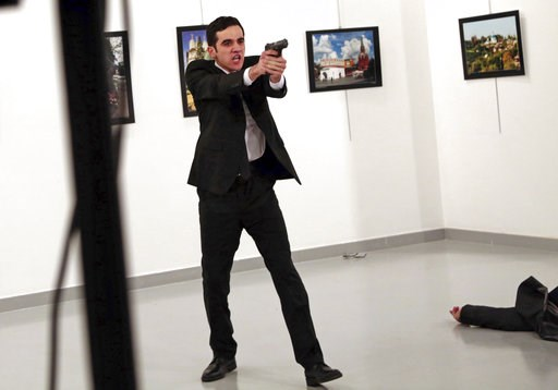 (AP Photo/Burhan Ozbilici, File). FILE - In this Monday, Dec. 19, 2016 file photo, Mevlut Mert Altintas, an off-duty policeman, shouts after shooting Andrei Karlov, right, the Russian ambassador to Turkey, at an art gallery in Ankara, Turkey. Altintas ...