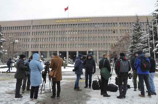 (AP Photo/Ali Unal). Members of the media work outside a court in Ankara, Turkey Tuesday, Jan. 8, 2019, where a trial has opened against 28 people accused of involvement in the 2016 killing of Russia's ambassador to Turkey. An off-duty police officer f...