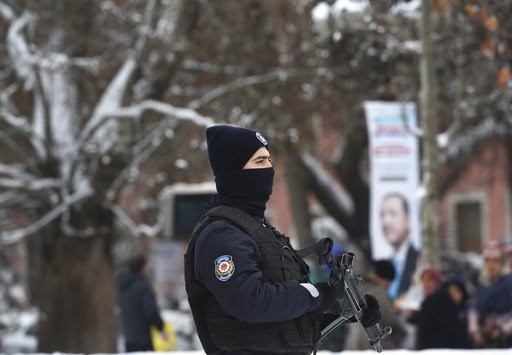 (AP Photo/Ali Unal). An armed police officer guards the perimeter of a court in Ankara, Turkey, on Tuesday, Jan. 8, 2019, where a trial has opened against 28 people accused of involvement in the 2016 killing of Russia's ambassador to Turkey. An off-dut...