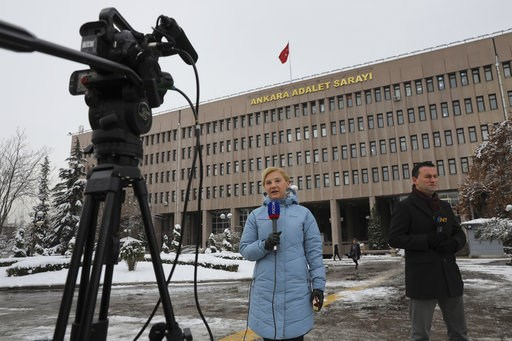 (AP Photo/Ali Unal). Members of the media work outside a court in Ankara, Turkey, on Tuesday, Jan. 8, 2019, where a trial has opened against 28 people accused of involvement in the 2016 killing of Russia's ambassador to Turkey. An off-duty police offic...