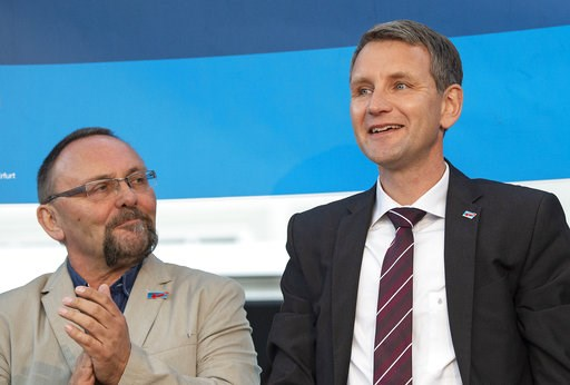 (AP Photo/Jens Meyer, File). File----Picture taken May 18, 2016, shows Frank Magnitz, member of the AfD parliamentary group Bundestag in Berlin, left, besides Bjoern Hoecke, head of AfD in the German state Thuringia, right, during a rally of Alternativ...