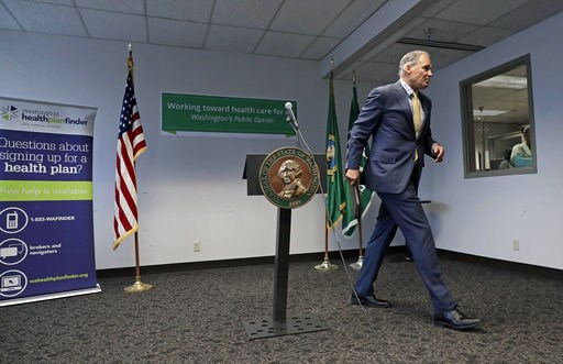 (AP Photo/Ted S. Warren). Washington Gov. Jay Inslee walks away from the podium after speaking Tuesday, Jan. 8, 2019, at a news conference in Seattle. Inslee, a likely Democratic presidential candidate, announced a proposal for a public health insuranc...