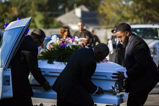 (Marie De Jesus/Houston Chronicle via AP). The casket of Jazmine Barnes is removed from the funeral hearse to be taken inside the Community of Faith Church for a memorial service, Tuesday, Jan. 8, 2019, in Houston.