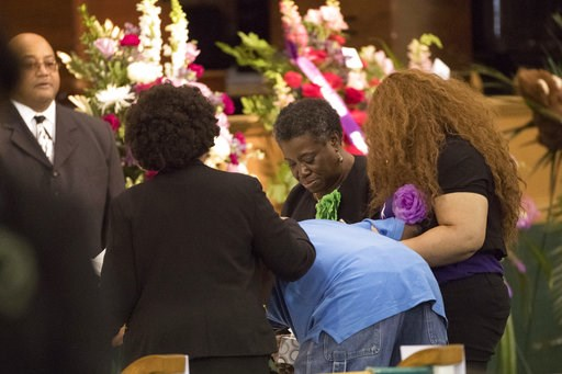 (Marie De Jesus/Houston Chronicle via AP). Three women hold a man as he becomes emotional approaching the casket of Jazmine Barnes during a viewing ceremony before the memorial services on Tuesday, Jan. 8, 2019 at the Community of Faith Church in Houst...