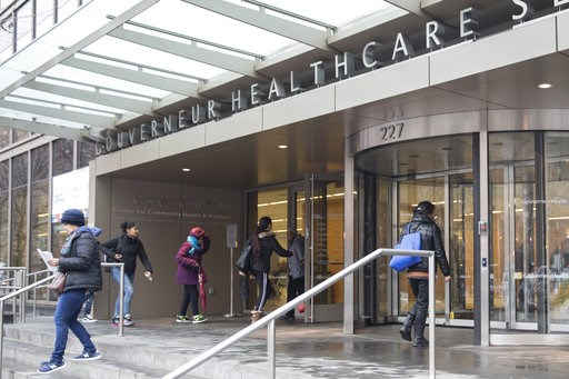 (AP Photo/Mary Altaffer). People enter New York City Health Hospitals Gouverneur Health building, Tuesday, Jan. 8, 2019, in New York. Mayor Bill de Blasio says New York City will spend up to $100 million per year to expand health care coverage to peopl...