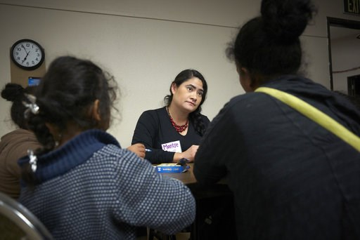 (AP Photo/Gregory Bull). In this Dec. 11, 2018, photo a family of asylum-seekers listens to a volunteer after arriving from an immigration detention center to a shelter in San Diego. Since late October 2016, the U.S. has been releasing asylum-seeking f...