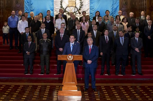 (AP Photo/Moises Castillo). Guatemala's President Jimmy Morales, center, gives a statement, at the National Palace in Guatemala City, Monday, Jan. 7, 2019. Guatemala announced that it is going to withdraw from UN-sponsored anti-corruption commission.