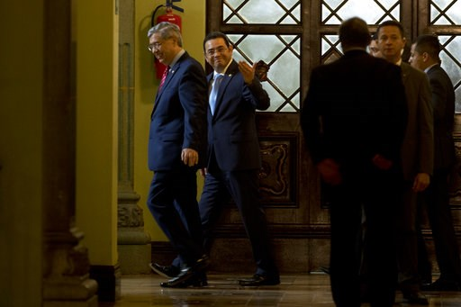 (AP Photo/Moises Castillo). Guatemala's President Jimmy Morales, center back, and Vice President Jafeth Cabrera walk after a statement at the National Palace in Guatemala City, Monday, Jan. 7, 2019. Guatemala announced that it is going to withdraw from...