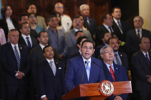 (AP Photo/Moises Castillo). Guatemala's President Jimmy Morales, flanked by his cabinet, gives a statement at the National Palace in Guatemala City, Monday, Jan. 7, 2019. Guatemala announced that it is going to withdraw from UN-sponsored anti-corruptio...